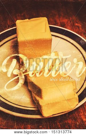 Tin sign advertising conceptual of sliced butter on white plate in vintage style. Old dairy ad