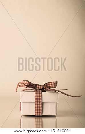 Retro White Christmas Gift Box Tied With Gingham Ribbon