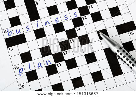 crossword puzzle with business plan written on it business concept