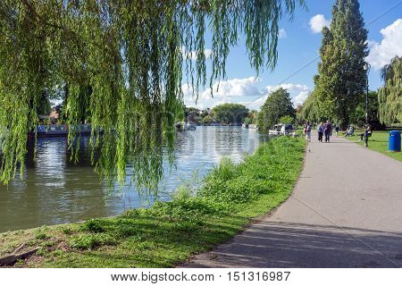 Caversham, Reading/UK. 2nd October 2016. The green and open Christchurch Meadows in Caversham on a warm, late summer's day with people wandering through the park.