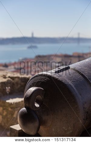 View On Lisbon With Old Metal Cannon Trunk
