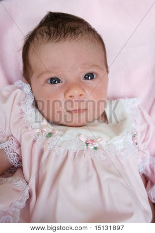 infant little girl in pink dress