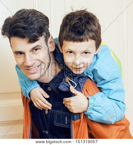 young handsome father with his son fooling around at home, lifestyle people concept close up