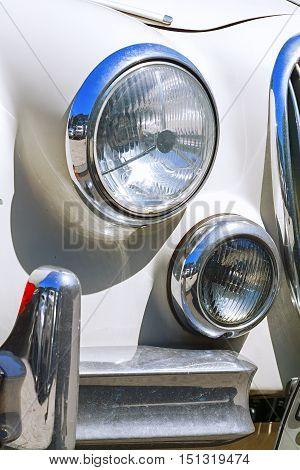 round headlight of the vintage car. auto, automobile.