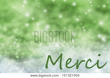 French Text Merci Means Thank You. Green Sparkling Christmas Background Or Texture With Snow. Copy Space For Your Text Here