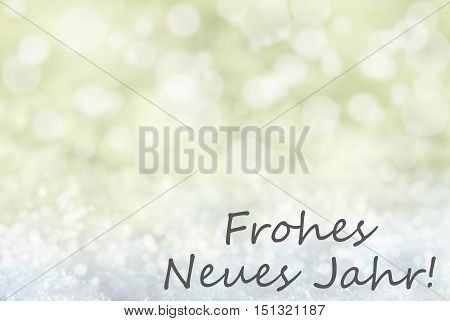 German Text Frohes Neues Jahr Means Happy New Year. Golden Bokeh Christmas Background Or Texture With Snow. Copy Space For Your Text Here