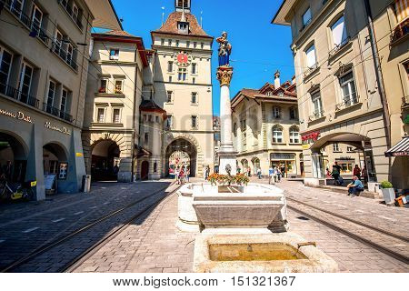 Bern, Switzerland - June 24, 2016: Street view with medieval tower and old city gate on Markt street in the old town of Bern city in Switzerland.