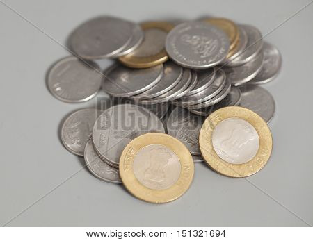 Indian Rupee coins isolated on gray background
