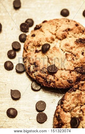Still life close-up on cookies with sprinkled chocolate chips droplets on kitchen bench