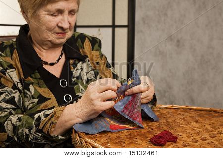 Old Woman With A Needle And A Thread