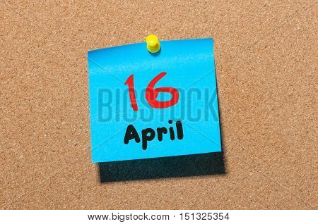April 16th. Day 16 of month, calendar on cork notice board, business background. Spring time, empty space for text.