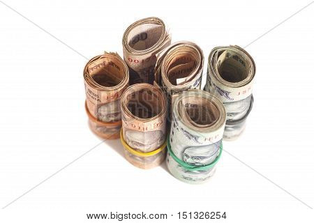 Rolls of Indian rupees isolated on white