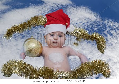The child is bathed in clouds with Christmas toys