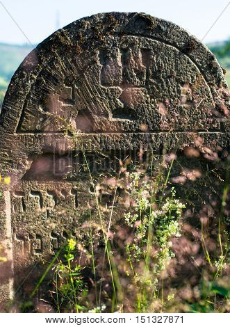 Closeup of the gravestone in the old Jewish cemetery in the Ukrainian Carpathian Mountains.