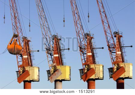 Four Cranes In The Port