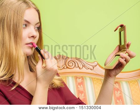 Attractive Woman Applying Lipstick. Make Up.