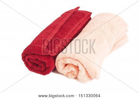 Red and pink towels isolated on white background