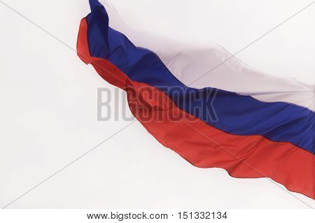 Russian flag waving in the wind on background of cloudy sky.