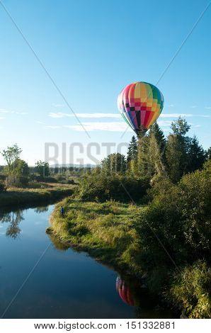Balloon over a stream during the Sussex Atlantic Balloon Festia