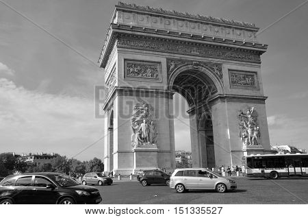 PARIS, FRANCE OCTOBER 19: Black and white Triumphal Arch de l Etoile ( arc de triomphe) . The monument was designed by Jean Chalgrin in 1806 in Paris, France on October 19, 2014