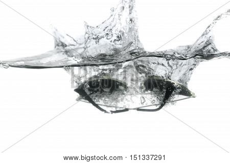 sunglasses fall in water splash bubbles show motion on white background with copy space.