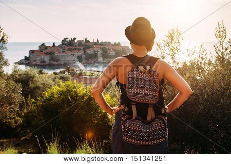 Woman Traveler With Backpack Near Sveti Stefan At Adriatic Sea