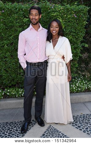 LOS ANGELES - SEP 25:  Alfred Enoch and Aja Naomi King arrives to the The Rape Foundation Annual Brunch on September 25, 2016 in Hollywood, CA
