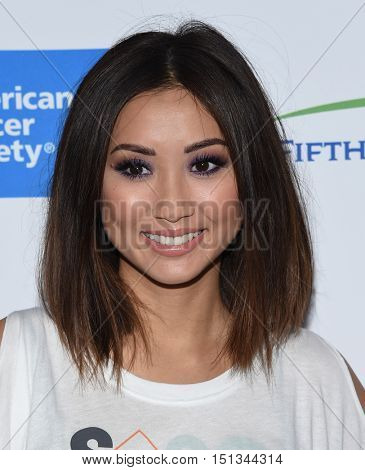 LOS ANGELES - SEP 09:  Brenda Song arrives to the Stand Up To Cancer 2016 on September 09, 2016 in Hollywood, CA