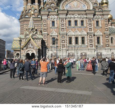 Saint Petersburg, Russia September 04, 2016: Tourists take pictures of the Savior on blood in St. Petersburg, Russia.