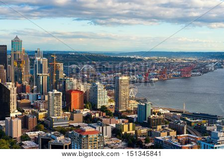 SEATTLE WA - SEPTEMBER 10 2016: Seattle's rapidly growing downtown and waterfront area with pro sports stadiums in the background is seen from the Space Needle at 520 feet.