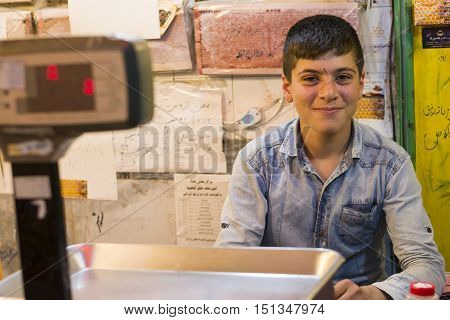 Ardabil- IRAN-September 21 2016 Happy Teenager Seller Assistant in Honeycomb Store