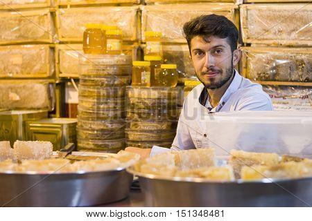 Ardabil- IRAN-September 21 2016 Honey Salesman at Store Night Scene