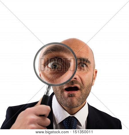 Businessman with a magnifying glass on white background