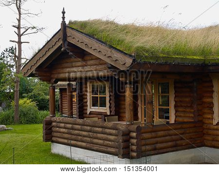 Typical Norwegian wooden mountain cabin log house great as a vacation place with turf roof Norway