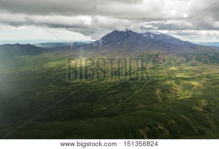Maly Semyachik is a stratovolcano. Kronotsky Nature Reserve on Kamchatka Peninsula. View from helicopter.