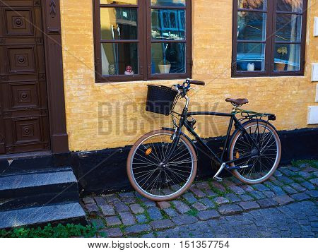 Vintage Classical Retro Style Bicycle in front of an old house Denmark