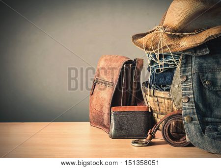 Clothing and old leather bags on the wooden.