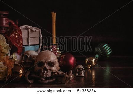 Skull and gifts for the festival on the old wooden.