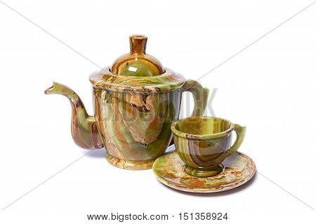 Teapots and cups made of natural onyx isolated on white background.