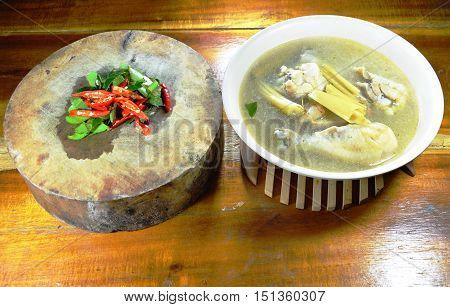 chicken leg spicy and sour soup and spice on wooden chop block