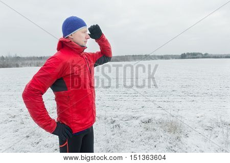 Man wearing protective sport jacket is starting his winter training session