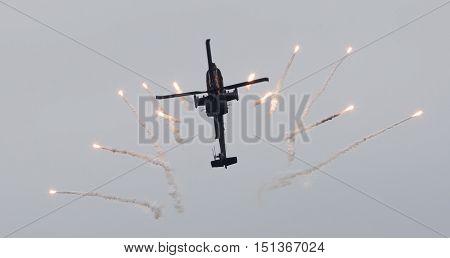 Leeuwarden, The Netherlands - Jun 11, 2016: Dutch Ah-64 Apache Attack Helicopter Firing Off Flares D