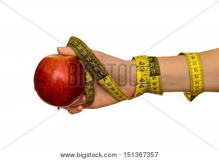 Woman's hand with red apple and measuring tape isolated on white