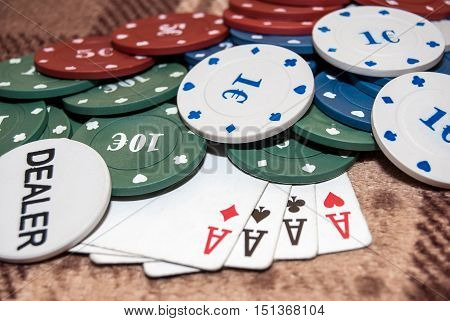 Cards and chips for poker on the table