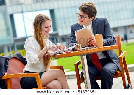 Young Executive Business Team Outdoors At A Table