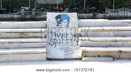 STRUGA MACEDONIA - OCTOBER 2 2016: Grafitti of David Bowie as Ziggy Stardust in Struga Macedonia. Gratitude text and paint on a marble platter in downtown of this city on a Lake Ohrid in Macedonia