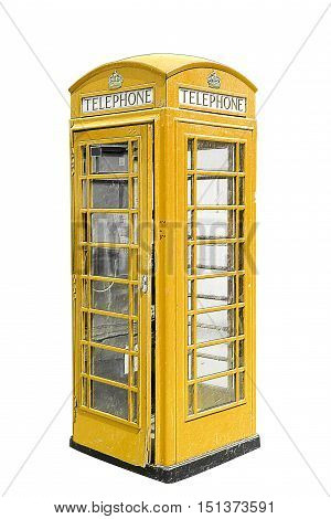 Classic British yellow phone booth in London UK, isolated