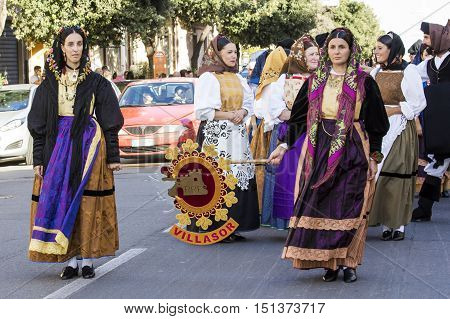 QUARTU S.E., ITALY - September 17, 2016: Parade of Sardinian costumes and floats for the grape festival in honor of the celebration of St. Helena. - Sardinia - Folk group of Villasor