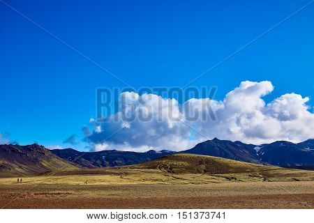 Travel to Iceland. Beautiful Icelandic landscape with mountains, sky and clouds. Trekking in national park Landmannalaugar