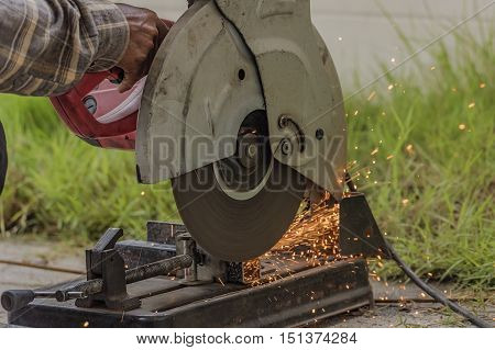 Sparks caused by cutting steel,worker are working.